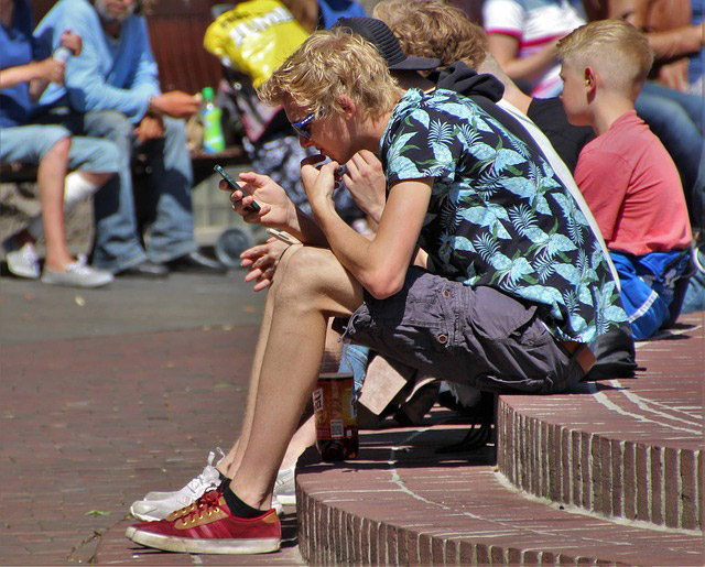 Kid on a cell phone not paying attention to his surroundings